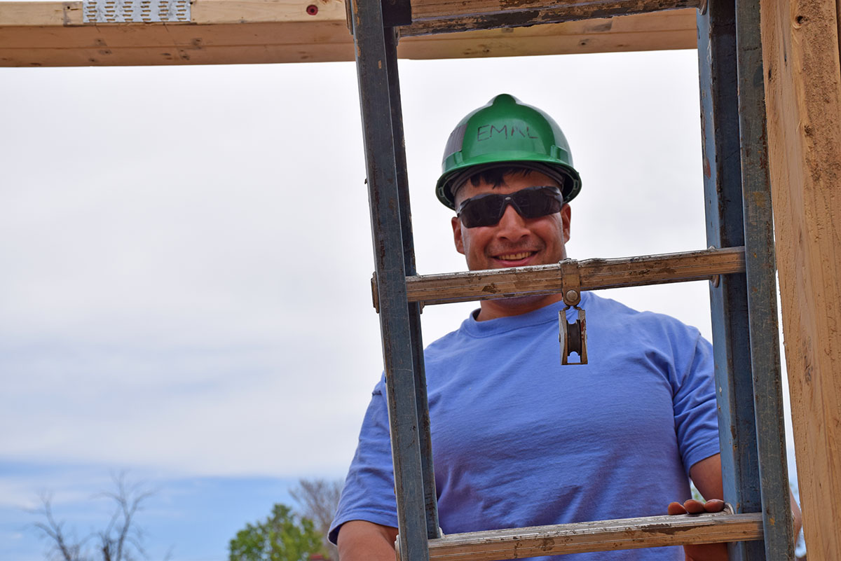 Emal working on site, completing his sweat equity