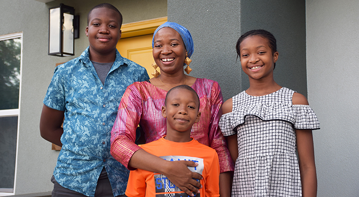 Hawa with her children at her home closing celebration